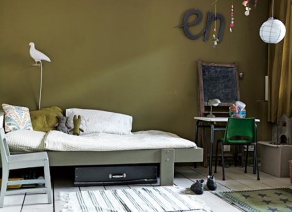 Green gender-neutral kids rooms on Growing Spaces | image via Elle Decoration