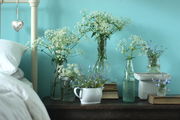 Brighten the bedside with multiple vases of fresh blooms | Growing Spaces
