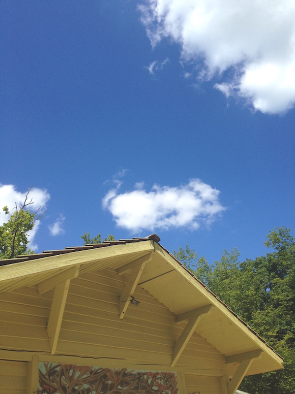 Camp hut and blue sky on a family road trip round Europe | Growing Spaces